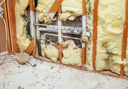 pipe in open wall surrounded by insulation