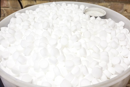 full bucket of white water softener tablets
